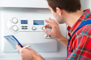 hvac contractor working with a gas boiler