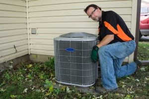 HVAC contractor performing routine HVAC maintenance and repairs
