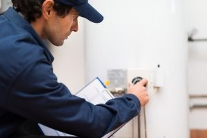 Gaithersburg, MD HVAC contractor turning the dial on a boiler system to repair it