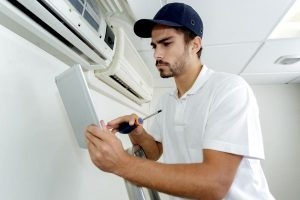 HVAC contractor working on installing a brand new air conditioning system for a resident in Maryland