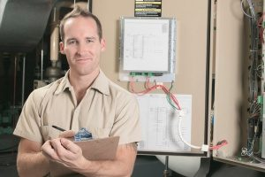 HVAC technician who is ready to conduct an AC repair or replacement for some Maryland homeowners