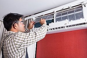 regularly scheduled HVAC maintenance being performed by a contractor that the homeowners may enjoy safe air and good indoor air quality