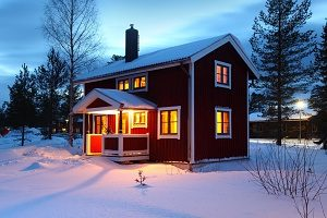 picture of houses in the winter using forced air furnaces for heat
