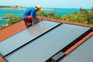 solar panels being installed on a roof as an internal heating system for the house