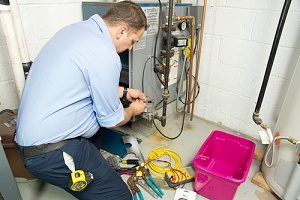 A HVAC Contractor from Presidential Heating & Air Conditioning conducting experienced furnace repair