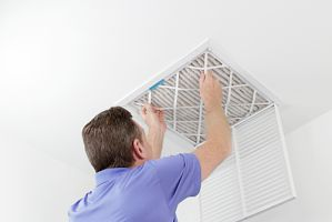 professional HVAC Contractor performing an extensive air duct cleaning
