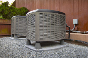 a residential hvac system unit next to a house