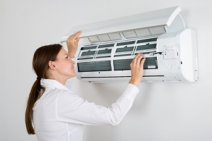 a woman confused about how to check the freon in her home air conditioner