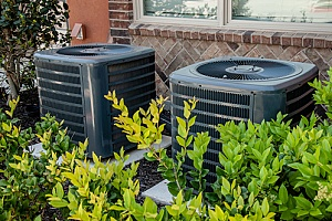 two adjacent air conditioning units from a central air system