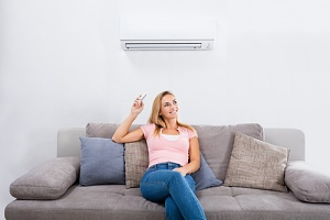 woman receiving the benefits of installing air conditioning in the summer