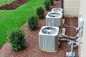 air conditioning units on the side of a home