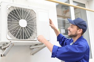 person installing a split system air conditioner