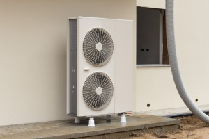 heat pump outside house with cooling system
