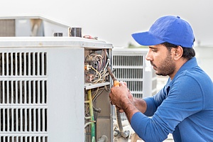 AC technician installing unit