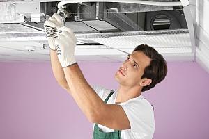 HVAC tech fixing unit