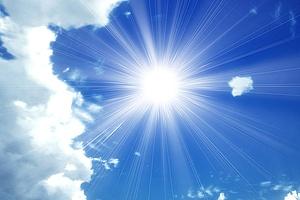 Sun giving off uv light in sky