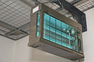 UV light system hanging from wall