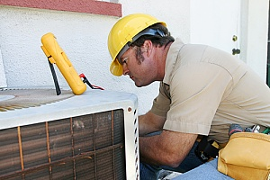 Contractor working to replace an ac unit
