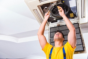 air conditioning contractor working on replacing a unit