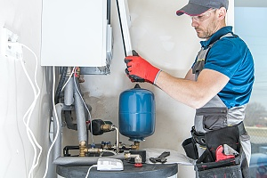 an HVAC professional installing a furnace in a commercial building