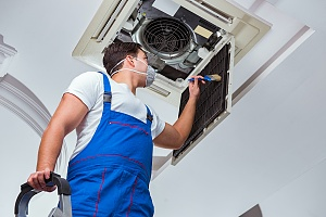 an HVAC professional installing an ac unit which is a tricky process and should be done by professionals