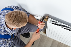 contractor working on a heating installation in a residential home