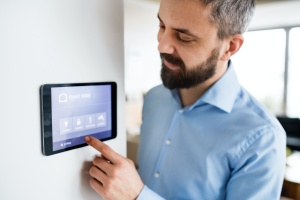 man working with his remote control thermostat
