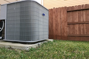 air conditioner unit sitting in back fo someone home